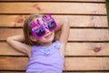 Adorable little girl in happy birthday glasses have fun outdoor this image has attached release Stock Image