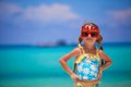 Adorable little girl in happy birthday glasses smiling and having fun at white beach this image has attached release Royalty Free Stock Photo