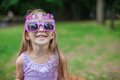 Adorable little girl in happy birthday glasses smiling outdoor this image has attached release Royalty Free Stock Photos