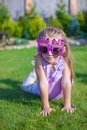Adorable little girl with happy birthday glasses smiling outdoor this image has attached release Royalty Free Stock Images