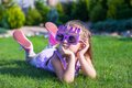 Adorable little girl in happy birthday glasses smiling outdoor this image has attached release Stock Photo