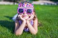 Adorable little girl in happy birthday glasses smiling outdoor this image has attached release Royalty Free Stock Photo