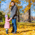 Adorable little girl with happy father in park at autumn this image has attached release Stock Images
