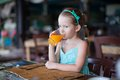 Adorable little girl having breakfast at resort restaurant this image has attached release Royalty Free Stock Image