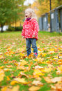 Adorable little girl having fun outdoors Royalty Free Stock Images