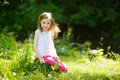 Adorable little girl having fun outdoors on beautiful summer day Royalty Free Stock Photo