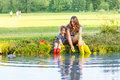 Adorable little girl and her mom playing with paper boats in a r young mother cute kid daughter river creative leisure kids Royalty Free Stock Photos