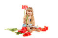 Adorable little girl holding bouquet of tulips Royalty Free Stock Photo