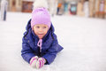 Adorable little girl laying on skating rink after the fall this image has attached release Stock Images
