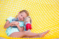 Adorable little girl relaxing in hammock Royalty Free Stock Photo