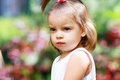 Adorable little girl serene and still her face expresses a thoughtful and contemplative look as she enjoys the outdoors Stock Photo