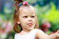 Adorable little girl serene and still showing her tongue years old Royalty Free Stock Images
