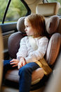 Adorable little girl sitting in car seat safely Stock Images