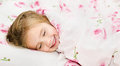 Adorable little girl sleep in the bed smiling Stock Photo