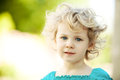Adorable little girl taken closeup outdoors in summer Stock Image