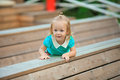 Adorable little girl walking outdoor and having fun in summer park Stock Photos