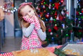 Adorable little girl in wore mittens baking christmas gingerbread cookies this image has attached release Royalty Free Stock Photography