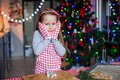 Adorable little girl in wore mittens baking christmas gingerbread cookies this image has attached release Stock Images