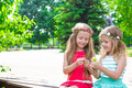 Adorable little girls enjoying warm summer day Royalty Free Stock Photo