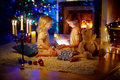 Adorable little girls opening a magical Christmas gift Royalty Free Stock Photo