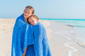 Adorable little girls together wrapped in towel at tropical beach Royalty Free Stock Photo