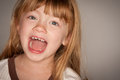 Adorable Red Haired Girl Laughing on Grey Royalty Free Stock Photo