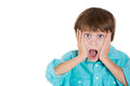 Adorable shocked kid with hands on face closeup portrait of isolated white background copy space Royalty Free Stock Photo