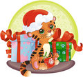 Adorable Tiger-cub with Christmas gifts Stock Photo