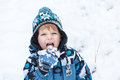 Adorable toddler boy having fun with snow on winter day little outdoors beautiful Royalty Free Stock Images