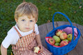 Adorable toddler eating fresh apple Stock Image