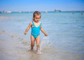Adorable toddler girl playing with beach toys Royalty Free Stock Photo