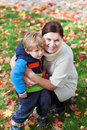 Adorable toddler hugging his mother Stock Photography