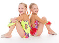Adorable twin girls gymnasts twins kids gymnast sport isolated on white background Stock Photography