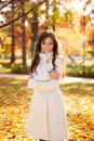 Adorable woman in autumn park standing warm coat Royalty Free Stock Image