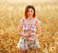 Adorable woman in field with flower Royalty Free Stock Image