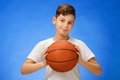 Adorable 11 year old boy child with basketball ball Royalty Free Stock Photo