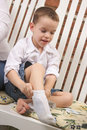 Adorable Young Boy Getting Socks On Royalty Free Stock Photography