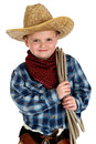 Adorable young boy wearing cowboy hat holding rope wearning Stock Photography