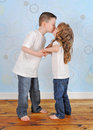 Adorable young brother and sister sharing a kiss Royalty Free Stock Image