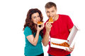 Adorable young couple relishing yummy pizza Royalty Free Stock Images