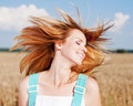 Adorable young girl shake hair in the field Royalty Free Stock Photos