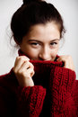 Adorable young woman in sweater at home smiling close up Royalty Free Stock Photography