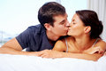 Adortable multiracial couple kiss bed home lifestyle Royalty Free Stock Image