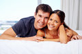 Adortable multiracial couple love together bed home lifestyle Royalty Free Stock Photography
