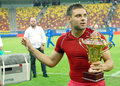 Adrian popa of steaua with the trophy bucharest pictured after romanian supercup between bucharesta and petrolul Stock Photos