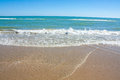 Adriatic Sea coast view. Seashore of Italy, summer sandy beach with clouds on horizon. Royalty Free Stock Photo