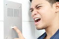Adult angry asian man shouting intercom Royalty Free Stock Photography