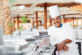 Adult arab chef man uniform food cooker resort hotel restaurant kitchen Stock Image