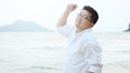 Adult Asian Fat man in white shirt  feeling despondent from  hard work be finding relaxing and meditation by walking and make calm Royalty Free Stock Photo
