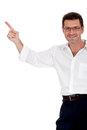 Adult attractive smiling man pointing his finger on the copyspace isolated white Stock Images